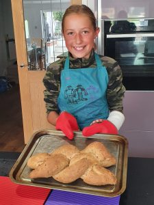 Cadet Emily showing off her bread baking skills
